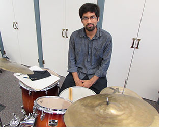 Deepak Gopinath in front of drums