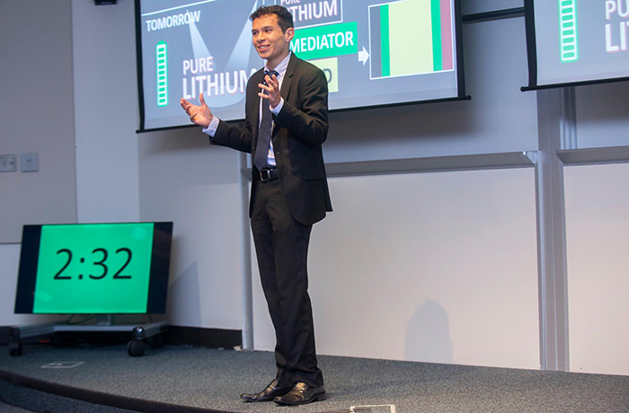 student presenting at 3MT competition