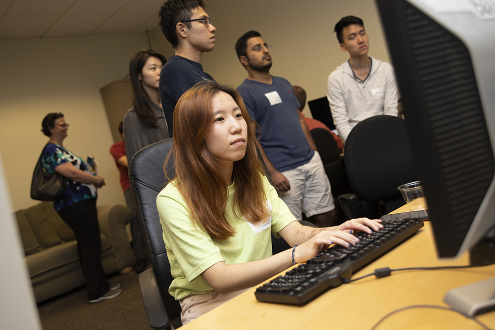 student sitting at a computer